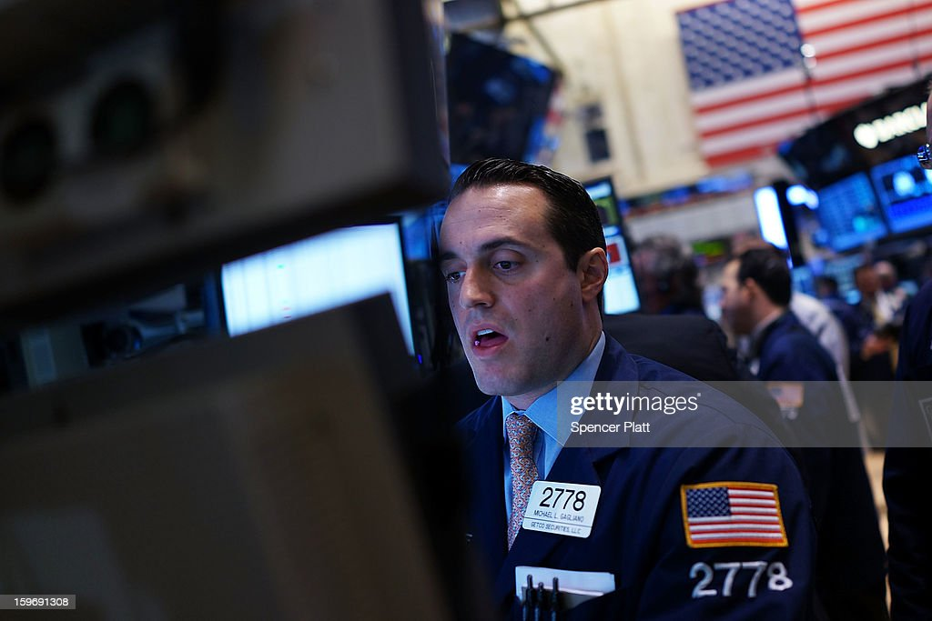 A trader works on the floor of the New York Stock Exchange on January 18, 2013 in New York City. A day after the Standard & Poor's 500-index rose to its highest level in five years, The Dow Jones industrial average was fluctuating between small losses and gains in morning trading.