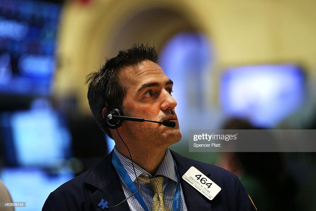 A trader works on the floor of the New York Stock Exchange on January 15, 2014 in New York City. The Dow rallied for a second straight day closing up 108 points.