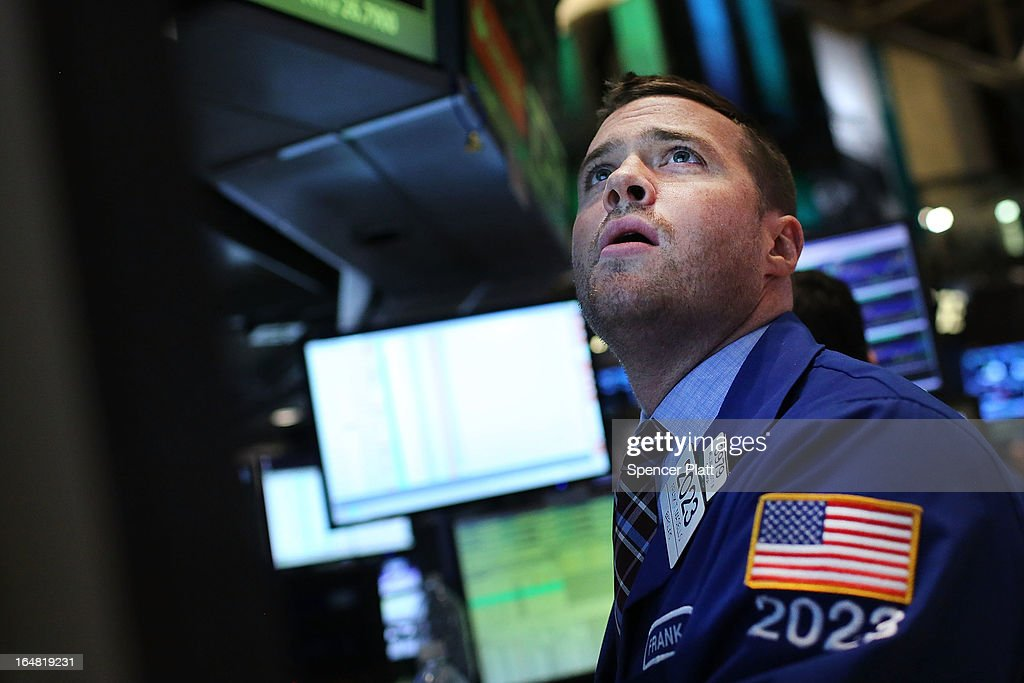 A trader works on the floor of the New York Stock Exchange on March 28, 2013 in New York City. The S&P 500 finished at an all time high, gaining 6 points, or 0.4%, to end at a record close of 1569.19.