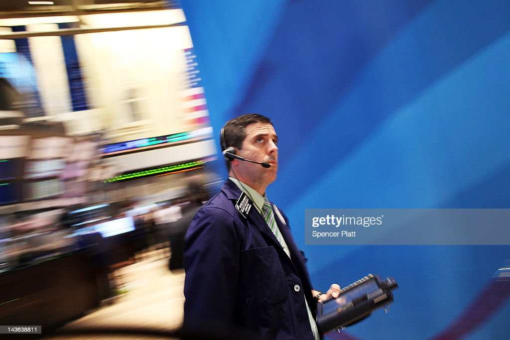A trader works on the floor of the New York Stock Exchange on May 1, 2012 in New York City. Following positive news of a rise in U.S. manufacturing activity, The Dow Jones industrial average rose almost 66 points, or 0.5%, to close at 13,279.40, the highest since December 2007.