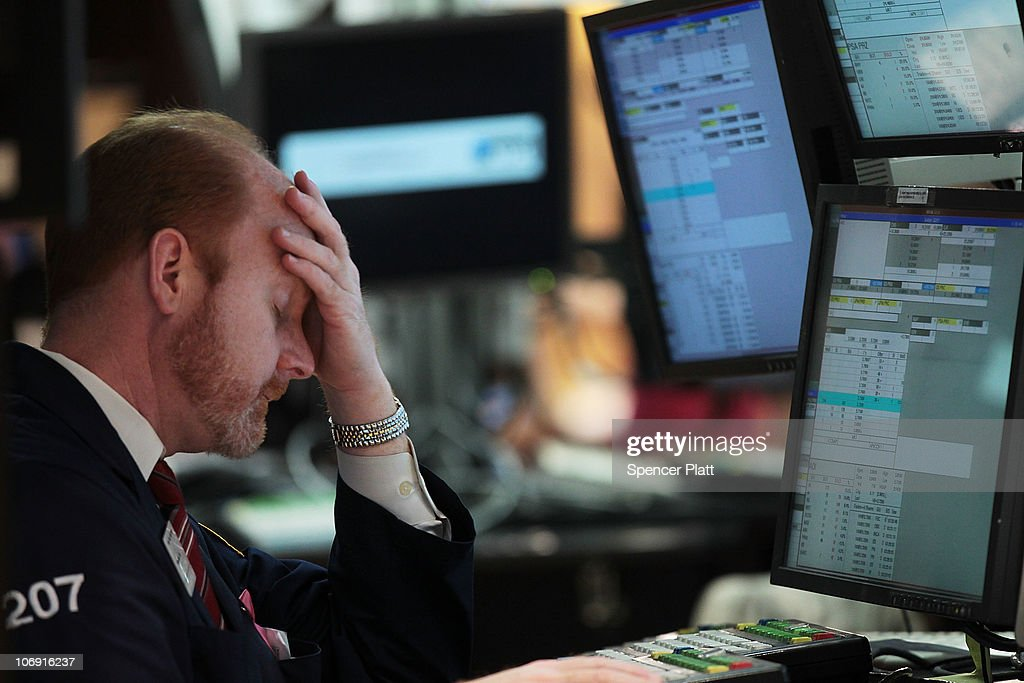 A trader works on the floor of the New York Stock Exchange on November 16, 2010 in New York City. Following continued worries over the economic outlook for Europe, China and the United States, the Dow Jones industrial average (INDU) was down 178 points in a preliminary tally.