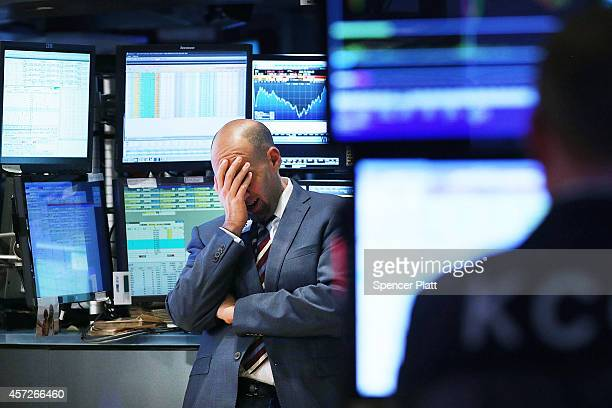 A trader works on the floor of the New York Stock Exchange on October 15 2014 in New York City As fears from Ebola and a global slowdown spread...