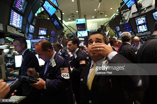 A trader works on the floor of the New York Stock Exchange September 15 2008 in New York City In afternoon trading the Dow Jones Industrial Average...