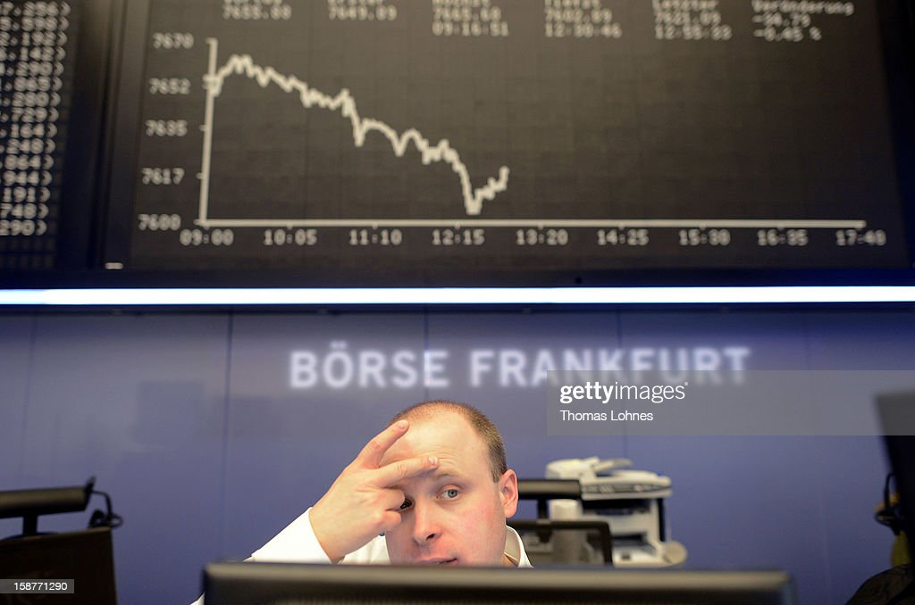 A trader works on the last day of trading for 2012 at the Frankfurt Stock Exchange on December 28, 2012 in Frankfurt, Germany. The DAX index of Germany's largest corporations finished the year at over 7,500, which represents a strong increase for the year. At the same time one year ago the index stood at just under 6,000.