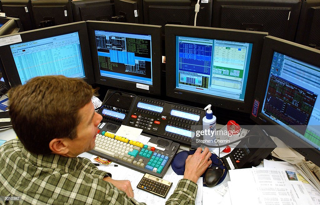 A trader works on the trading floor of JP Morgan Chase February 24, 2004 in New York City.