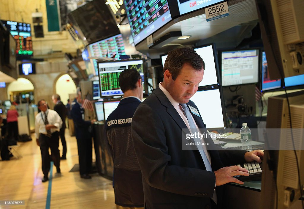 A trader works the floor of the New York Stock Exchange on July 13, 2012 in New York City. The Dow Jones Industrial Average rallied July 13, closing up almost 204 points to finish at 12,777. The rally ended a 6-day slump, the longest since mid-May.