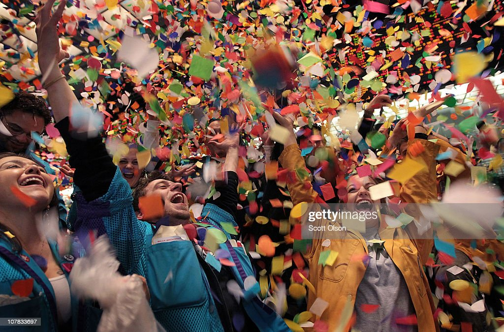 Traders and clerks at the CME Group toss confetti to celebrate the final trading session of the year December 31, 2010 in Chicago, Illinois. The U.S. stock indices posted positive returns for 2010 with the S&P, Dow and Nasdaq on pace to close the year up over 10 percent.