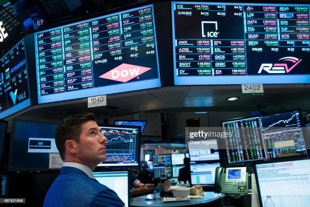 Traders and financial professionals work on the floor of the New York Stock Exchange (NYSE) ahead of the closing bell, June 19, 2017 in New York City. As tech stocks surged, the Dow Jones industrial average rose over 140 points on Monday.