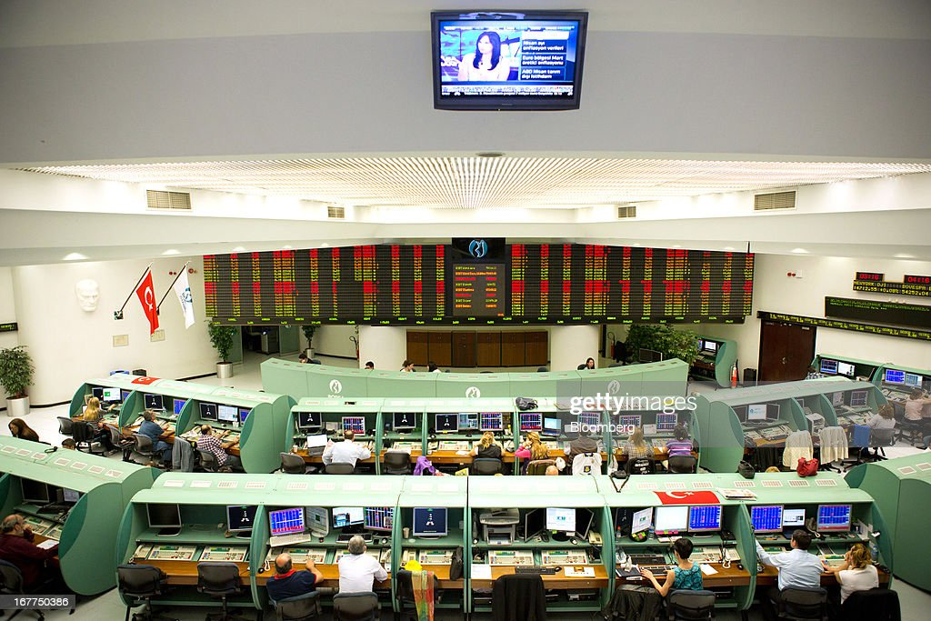 Traders are seen working on the floor of the Borsa Istanbul, the stock exchange in Istanbul, Turkey, on Monday, April 29, 2013. Turkey is building a financial district in Istanbul and merged the 28-year-old Istanbul Stock Exchange with gold and derivatives exchanges into Borsa Istanbul this month. Photographer: Kerem Uzel/Bloomberg via Getty Images