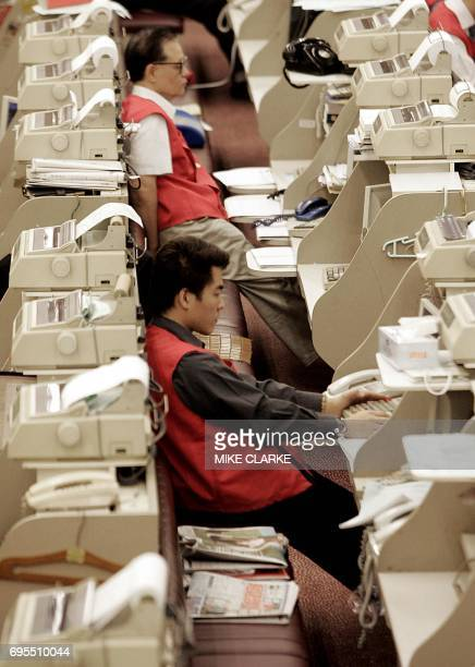 Traders at work shortly after opening at the Hong Kong Stock Exchange 15 December 2004 Shares of Air China Ltd the nation's biggest international...