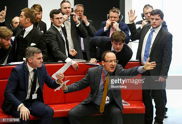 Traders brokers and clerks shout and gesture on the trading floor of the open outcry pit at the London Metal Exchange at their new premises on...