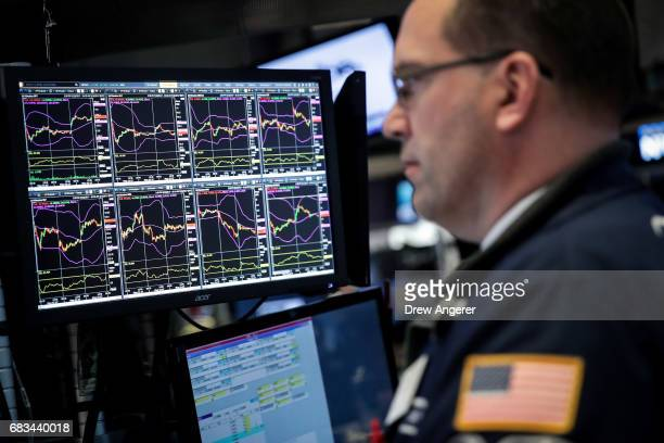 A trader's computer screen is displayed as financial professional work on the floor of the New York Stock Exchange ahead of the closing bell May 15...