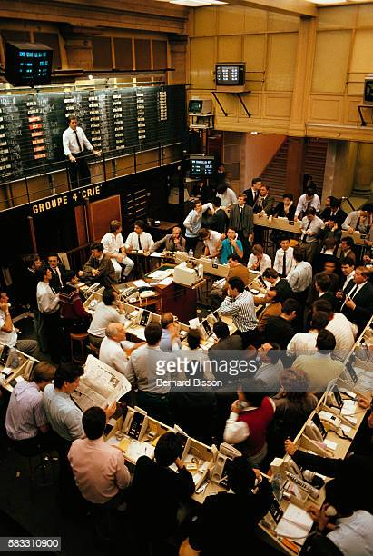 Traders crowd the floor at the Paris Stock Exchange a few days after Black Monday on October 19 the largest market crash since Black Tuesday in 1929...