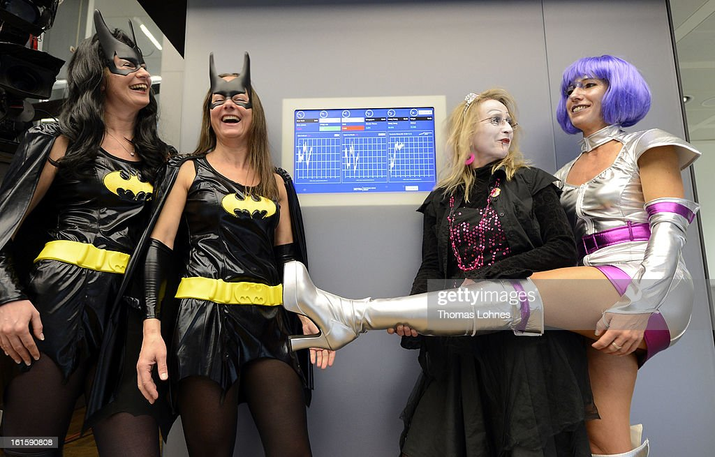 Traders dressed as carnival fools poses for photographers on the trading floor of the Frankfurt Stock Exchange on February 12, 2013 in Frankfurt am Main, Germany. Carnival has been an annual tradition in parts of western Germany since 1823 and workers often celebrate free-spirited merrymaking by wearing carnival fancy dress costumes before the beginning of Lent.