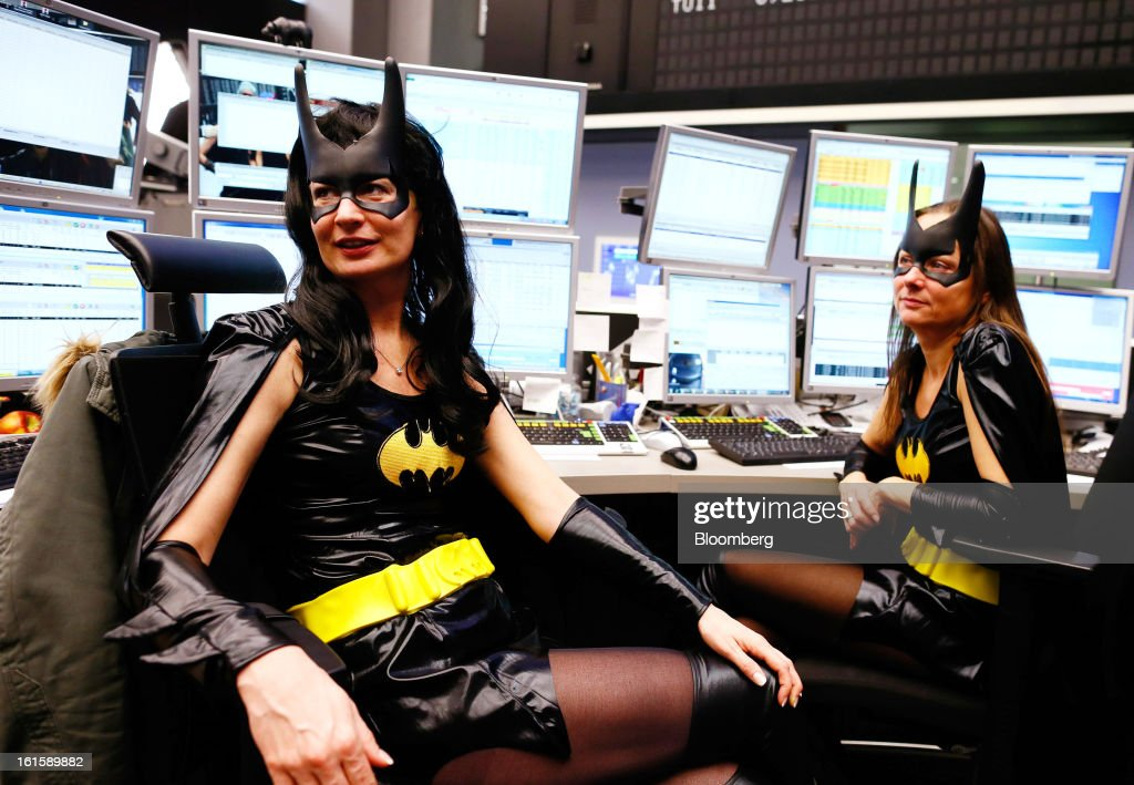 Traders dressed in Batman costumes take a break between trades while on the floor of the Frankfurt Stock Exchange during Carnival Tuesday in Frankfurt, Germany, on Tuesday, Feb. 12, 2013. Traders wear costumes as part of a long-standing tradition in honor of Germany's Carnival festivities. Photographer: Ralph Orlowski/Bloomberg via Getty Images