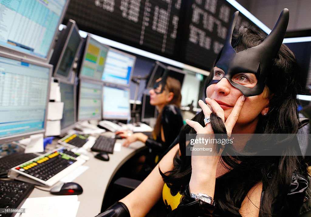 Traders dressed in Batman costumes work on their computers while on the floor of the Frankfurt Stock Exchange during Carnival Tuesday in Frankfurt, Germany, on Tuesday, Feb. 12, 2013. Traders wear costumes as part of a long-standing tradition in honor of Germany's Carnival festivities. Photographer: Ralph Orlowski/Bloomberg via Getty Images