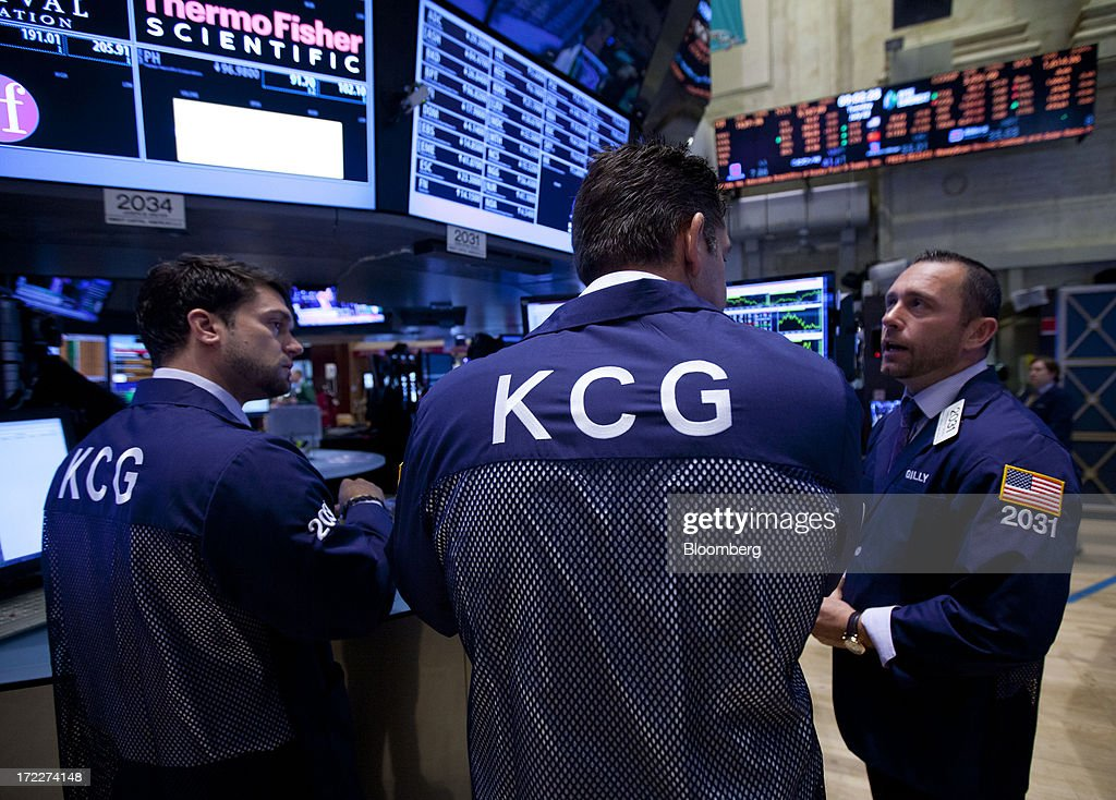 Traders from KCG Holdings Inc., the new company formed by the merger between Getco LLC and Knight Capital Group Inc., work at KCG's trading post at the New York Stock Exchange (NYSE) in New York, U.S., on Tuesday, July 2, 2013. Getco LLC and Knight Capital Group Inc. completed their merger, creating a public company that will play one of the biggest roles in the daily functioning of the U.S. stock market. The new company, KCG Holdings Inc., began trading today at the NYSE. Photographer: Jin Lee/Bloomberg via Getty Images