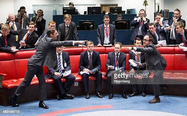 Traders gesture as they work from the trading floor of the open outcry pit at the London Metal Exchange in London UK on Tuesday April 8 2014 The...