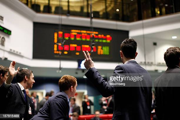 Traders gesture as they work on the trading floor of the London Metal Exchange in London UK on Friday Dec 7 2012 The London Metal Exchange's $22...