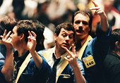 Traders gesturing on stock trading floor, USA