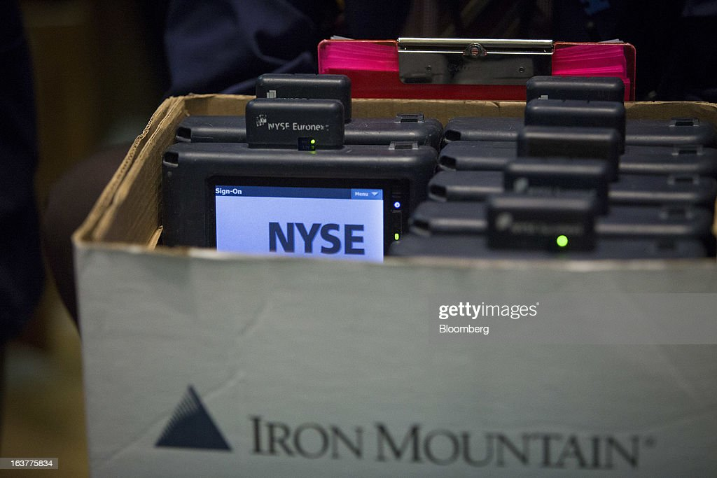 Trader's handheld devices are stored in a box at the New York Stock Exchange (NYSE) in New York, U.S., on Friday, March 15, 2013. U.S. stocks fell, sending the Dow Jones Industrial Average lower for the first time in 11 days, as a report showed consumer confidence unexpectedly fell in March. Photographer: Scott Eells/Bloomberg via Getty Images