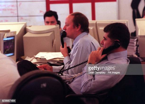 Traders in the dealing room at the Charterhouse Merchant Bank in London today stare at their computer screens as share prices continue to plummet The...