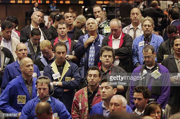 Traders in the soybean pit at the Chicago Board of Trade observe a moment of silence before the opening bell to mark the anniversary of the attacks...