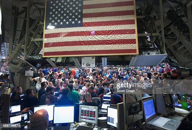 Traders in the Standard Poor's 500 stock index options pit at the Chicago Board Options Exchange react to the Federal Reserve's decision on interest...