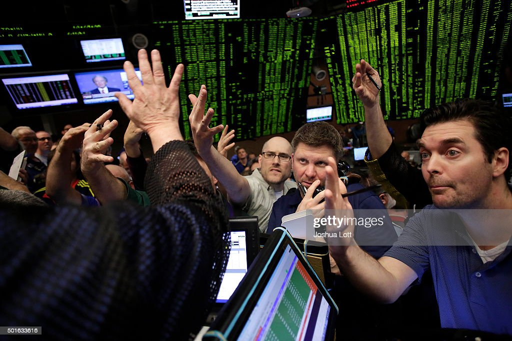 Traders in the Standard Poor's 500 stock index options pit at the Chicago Board Options Exchange react after it was announced that they Federal...
