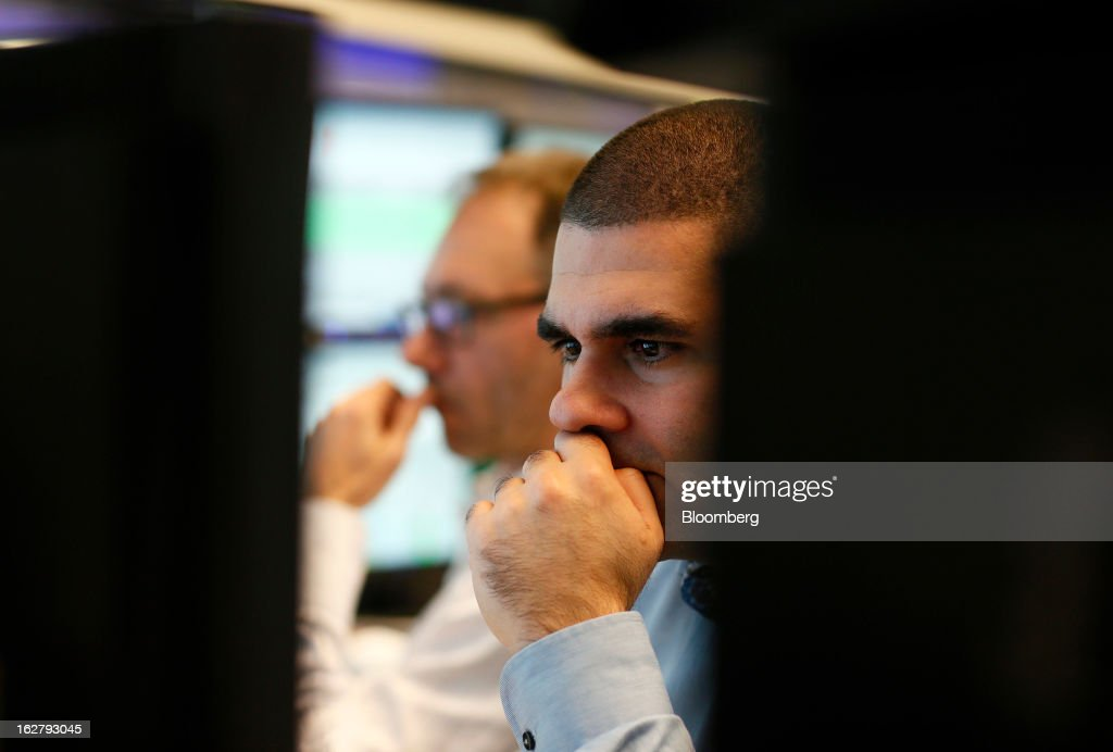 Traders monitor financial data on their computer screens as they work inside the Frankfurt Stock Exchange in Frankfurt, Germany, on Tuesday, Feb. 27, 2013. Stocks rose, the euro strengthened from a seven-week low and Italian 10-year bonds gained after the country sold 6.5 billion euros ($8.5 billion) of debt amid political turmoil. Photographer: Ralph Orlowski/Bloomberg via Getty Images