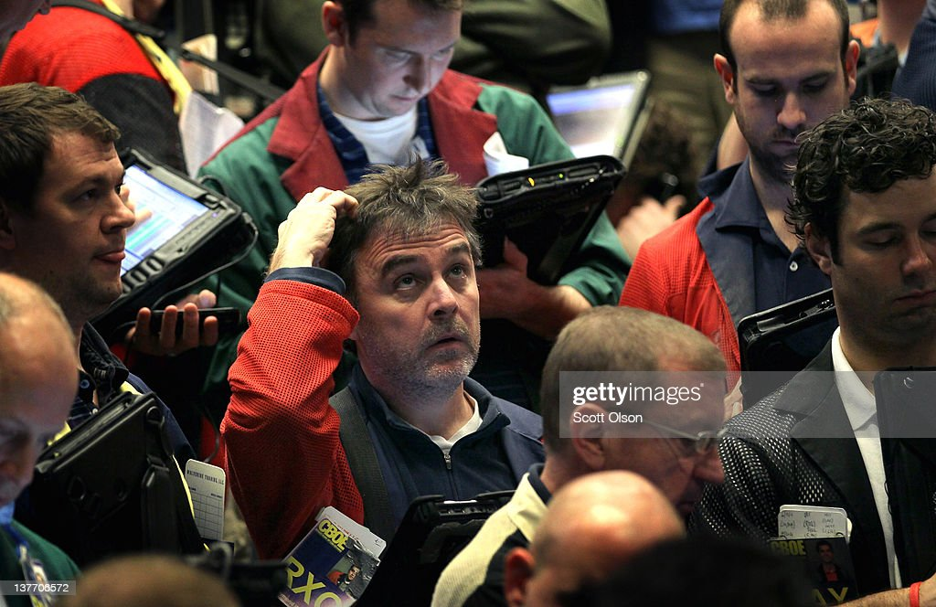 Traders monitor prices in the Standard & Poor's 500 stock index options pit at the Chicago Board Options Exchange (CBOE) following the Federal Open Market Committee meeting on January 25, 2012 in Chicago, Illinois. Following the meeting the Fed, which left interest rates unchanged, said it does not plan any rate changes until late 2014.