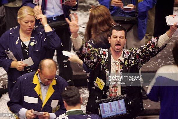 Traders on the agriculture trading floor at the Chicago Board of Trade make some of their final trades of the year at the close of trading December...