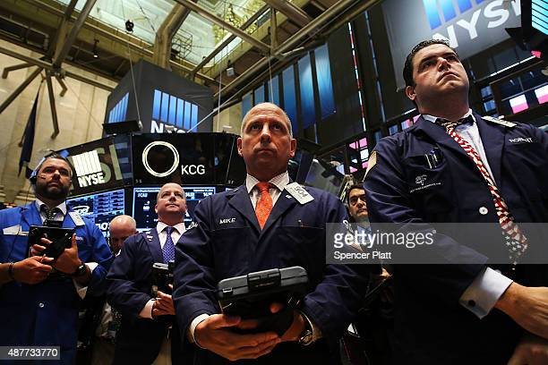 Traders on the floor of the New York Stock Exchange participate in a moment of silence in remembrance of the events of September 11 2001 on September...