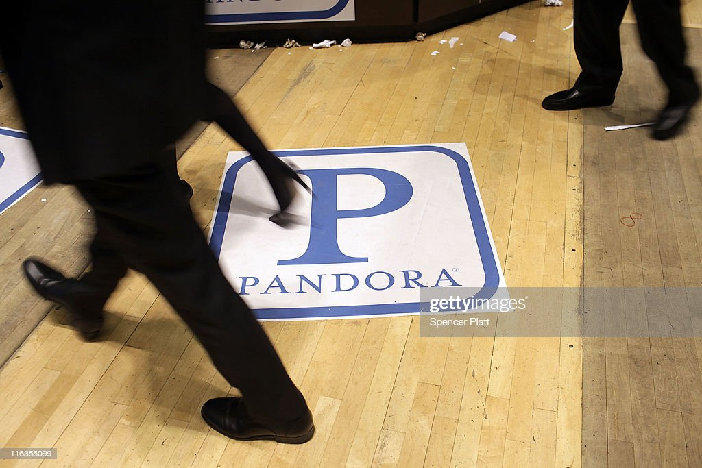 Traders on the floor of the New York Stock Exchange walk over insignia for Pandora Media Inc., the online-radio company, on its first day of trading as a public company on June 15, 2011 in New York City. Pandora stock rose as much as 63 percent to $26 following its debut on the New York Stock Exchange, under the symbol P. Reversing much of the previous day's gains, stocks fell Wednesday as more news emerged about the fragility of the American and global economy. The Dow Jones Industrial Average fell 88 points, or 0.8%, to 11987 in morning trading.