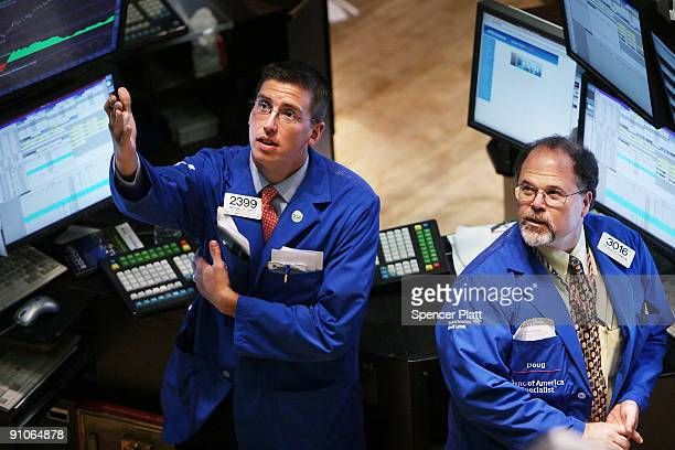 Traders on the floor of the New York Stock Exchange watch the announcement from the US Federal Reserve on any lending rate changes September 23 2009...