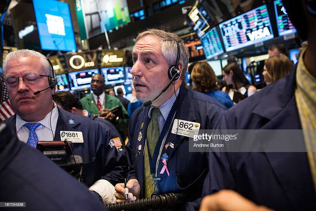 Traders on the floor of the New York Stock Exchange (NYSE) work as Twitter's initial price offering (IPO) is finalized on November 7, 2013 in New York City. Twitter went public November 7, on the NYSE selling at a market price of $45.10, with the initial price being set at $26 on November 6.