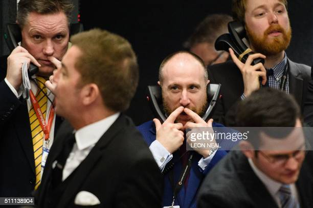 TOPSHOT Traders operate in the Ring the open trading floor of the new London Metal Exchange in central London on February 18 2016 The Ring has...