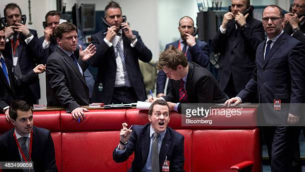 A traders reacts from the open outcry pit on the trading floor at the London Metal Exchange in London UK on Tuesday April 8 2014 The London Metal...