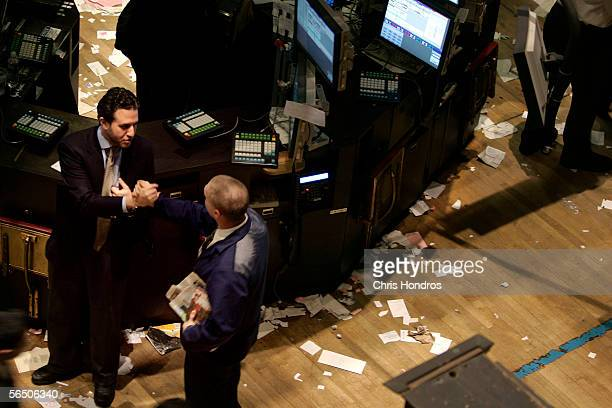 Traders say goodbye at the end of the last trading day of the year December 30 2005 on the floor of the New York Stock Exchange in New York City...