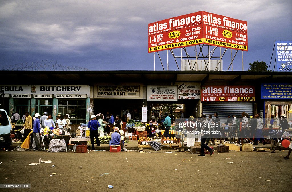 Traders sell goods at Baragwanath taxi station in Soweto, South Africa