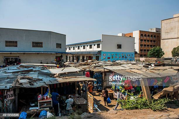 Traders sell goods from their corrugated iron roofed shacks at a street market in Lusaka Zambia on Thursday Oct 8 2015 Zambian Finance Minister...