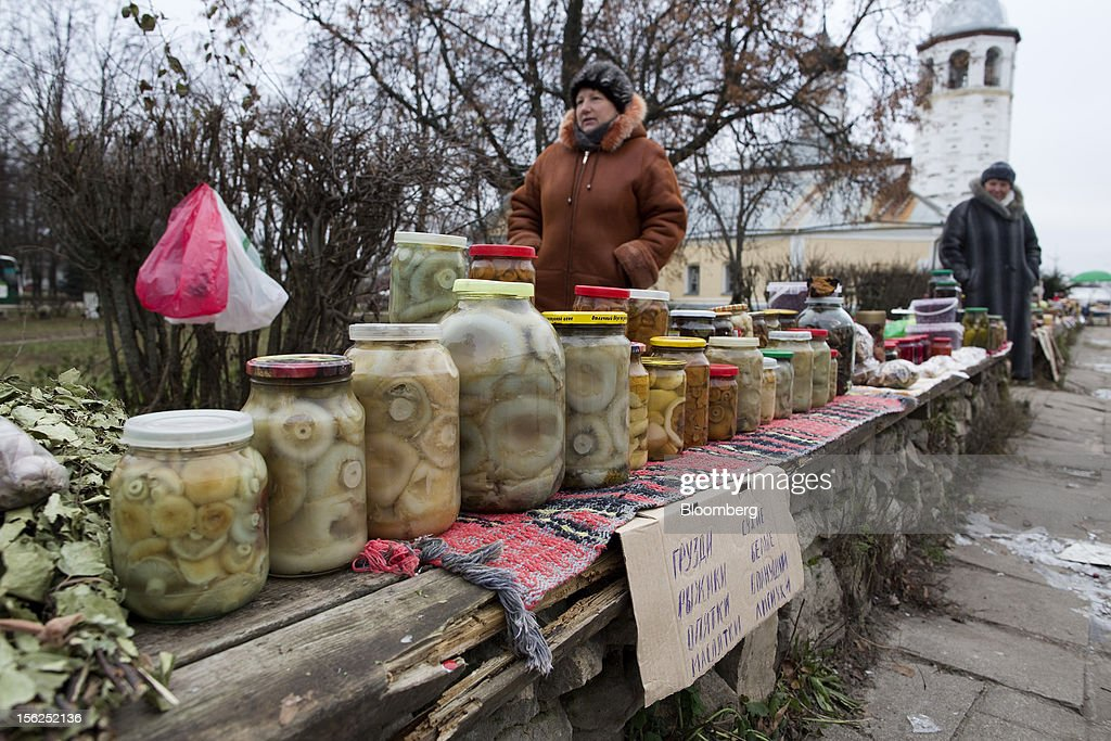 Traders sell jars of pickled mushrooms from a street stall in Suzdal, Russia, on Sunday, Nov. 11, 2012. Russia has one of the world's lowest retirement ages, set in 1932 during the Stalin era. Photographer: Andrey Rudakov/Bloomberg via Getty Images
