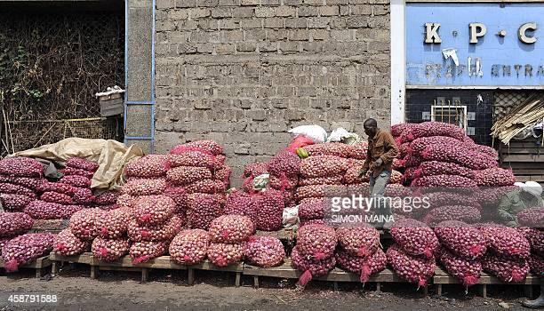 Traders sell onions a fresh produce market in Nairobi on November 11 2014 AFP PHOTO/SIMON MAINA