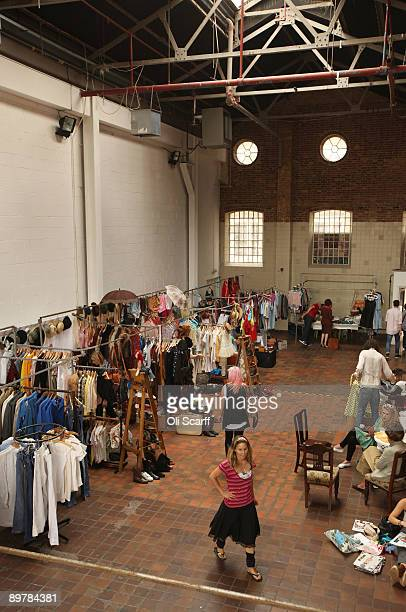 Traders set up their vintage clothing and accessories stalls on the first day of a vintage popup market in The Boiler House on Brick Lane on August...