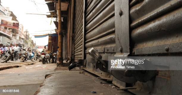 Traders shut down business for a day to protest against GST roll out from today midnight at Aminabad Market on June 30 2017 in Lucknow India The...