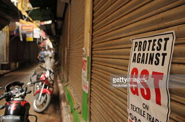 Traders shut down shops to mark their protest against Goods and Services Taxes which will be effected from today midnight at main business hub...