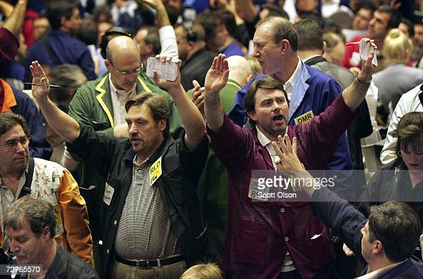 Traders signal offers in the Corn Futures pit at the Chicago Board of Trade December 7 2006 in Chicago Illinois Demand for corn to fuel the growing...