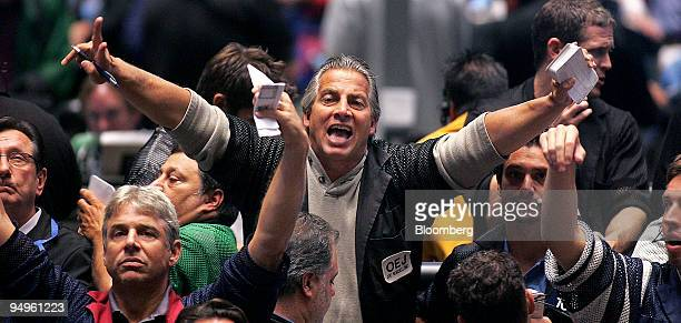 Traders signal orders in the SP 500 pit at CME Group Inc's Chicago Board of Trade shortly after the Federal Open Market Committee rate decision in...