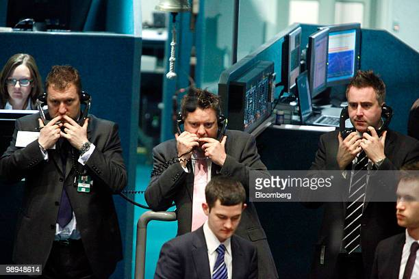 Traders speak on the telephone while on the floor of the London Metal Exchange in London UK on Monday May 10 2010 The euro rallied and stocks climbed...