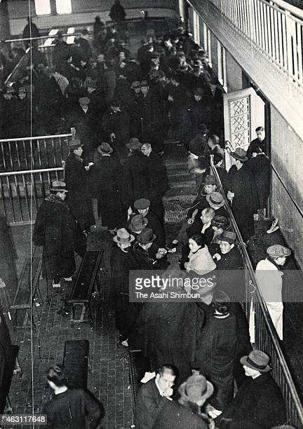 Traders stand as operation is suspended during the February 26 Incident on February 26 1936 in Tokyo Japan